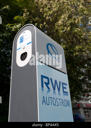 New electric car plug-in charging station operated by RWE on Berlin street Germany - Stock Photo