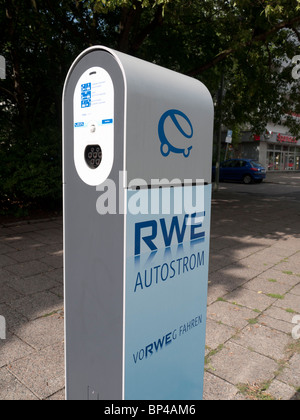 New electric car plug-in recharging station operated by RWE on Berlin street Germany - Stock Photo