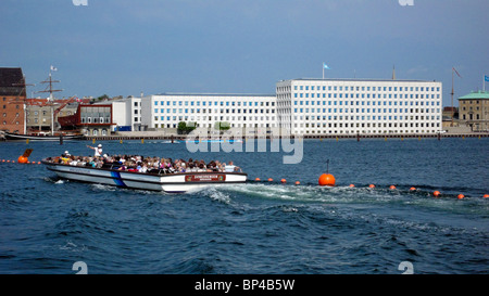 Copenhagen Harbour cruise vessel Svinedrengen with A.P. Møller - Mærsk A/S headquarters on Esplanaden in the background