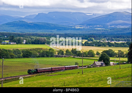 Strathspey Railway heritage train pulled by tank steam engine Braeriach arrives at Broomhill Station south of Grantown - Stock Photo