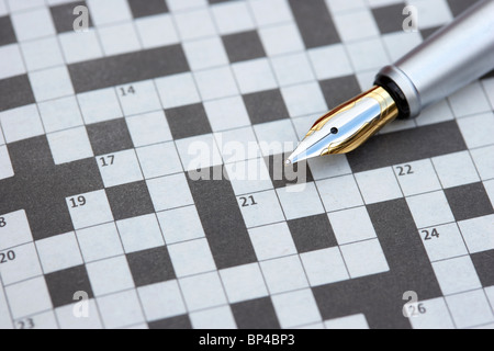fountain pen nib on a blank crossword in a newspaper in the uk - Stock Photo