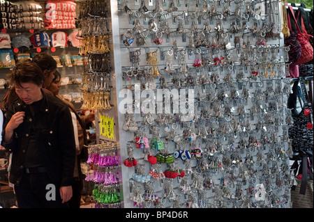 Paris, France, Tourists near Eiffel Tower, Buying Souvenirs in Shop - Stock Photo