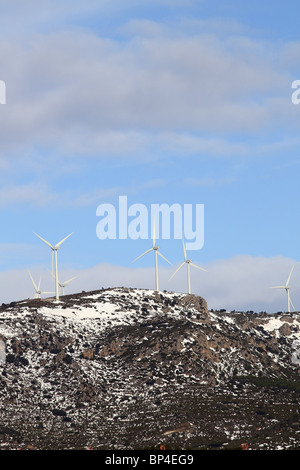 aerogenerator electric windmills on snow mountain - Stock Photo