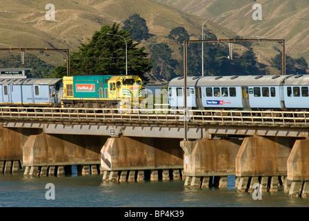 Wellington suburban train and Auckland to Wellington long distance train on Paremata Bridge, Pauatahanui Inlet, - Stock Photo