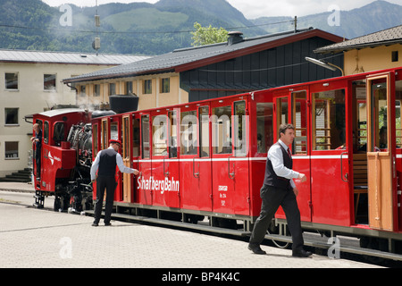 Red steam train on rack and pinion railway station platform to Schafberg mountain. St Wolfgang, Salzkammergut, Austria - Stock Photo