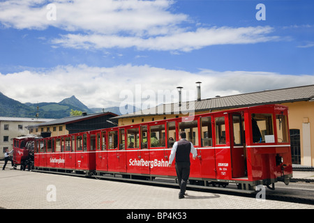 Red steam train on rack and pinion in railway station platform to Schafberg mountain. St Wolfgang, Salzkammergut, - Stock Photo