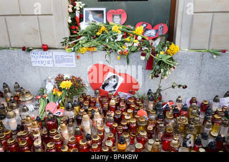 Warsaw Poland: Flowers and candles by The Presidential Palace in memory of president Lech Kaczynski and 95 others... - Stock Photo