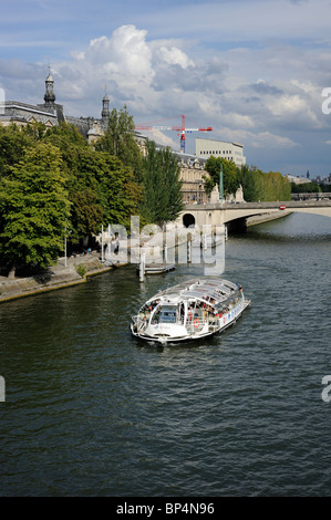 Tourists enjoying a cruse on batobus on Seine river, Paris, France - Stock Photo