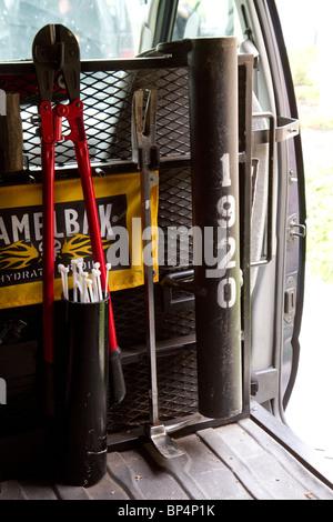 Inside police swat van. Entry tools. Bolt cutters, battering ram, flexicuffs etc. Street Narcotics Unit. Kansas - Stock Photo