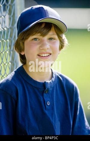 Portrait of 12 year old boy baseball player.