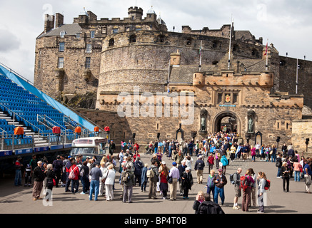 Crowds of tourists in Edinburgh Castle Esplanade, Scotland UK, Great Britain, with seating for the Military Tattoo - Stock Photo