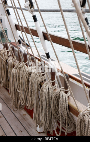 Close up of Ropes and Rigging on an old sail ship holding up the main mast and sails - Stock Photo
