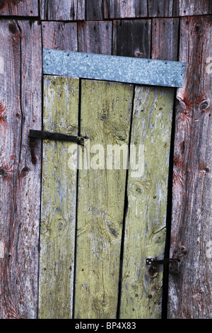 Traditional Nordic shed outhouse with odd shaped door detail flaking old paint Aland archipelago & Traditional Nordic shed outhouse with odd shaped door detail ... pezcame.com