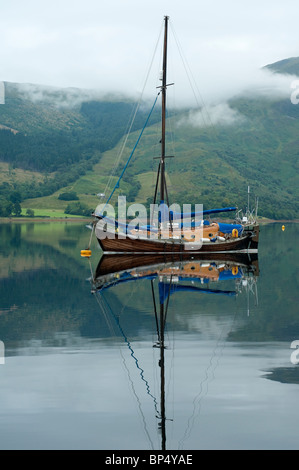 A lovely sailboat on Loch Leven - Stock Photo
