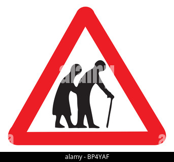 uk road sign warning of nursing home old people oap oaps seniors disabled couple man and woman infirm walking stick - Stock Photo