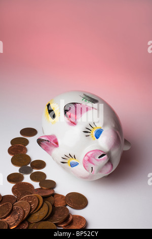 Fallen over Piggy Bank emptied of cash. - Stock Photo