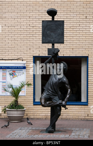 Sculpture of injured man outside St. Mary's Hospital with map of the Hospital, Paddington, London, UK, Europe, EU - Stock Photo