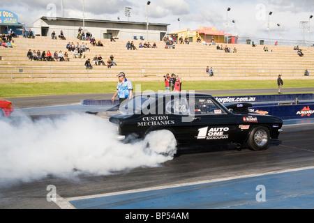 Drag racing Ford Capri performing a massive tyre smoking burnout at Western Australia's Perth Motorplex - Stock Photo