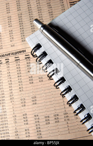 Steel pen and notebook on newspaper. Business concept. - Stock Photo