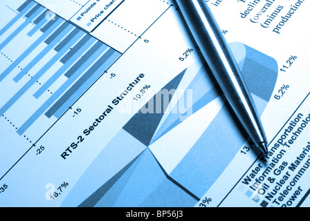 Steel pen laying on printed diagram. - Stock Photo