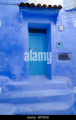 Blue House, Blue Door, Blue Walls & Front Steps to House, Chefchaouen, Morocco - Stock Photo
