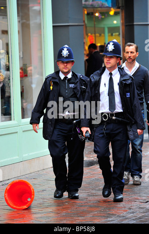 Met Police officers on Patrol in Carnaby street, London - Stock Photo