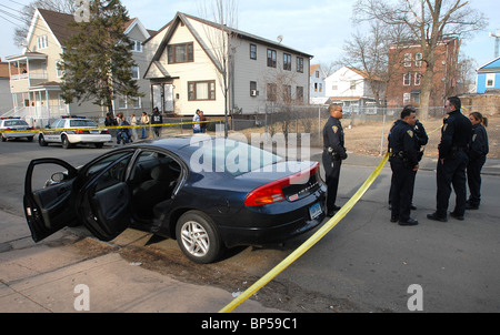 Police in New Haven CT USA look for suspects after a drive by shooting and car chase in stolen car. - Stock Photo