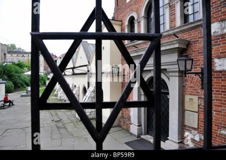 View of Old Synagogue through metal ornate fence, Kazimierz Poland,Europe - Stock Photo