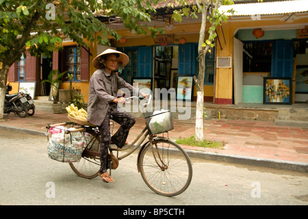 Woman in the streets of Hoi Han - Stock Photo