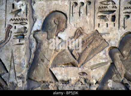 SCRIBE REGISTERING THE NUMBERS OF THE ENEMY DEAD. RELIEF IN THE GREAT TEMPLE OF MEDINET HABU DEPICTING THE BATTLES - Stock Photo