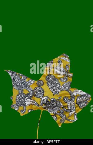 Paisley maple leaf on green background - Stock Photo