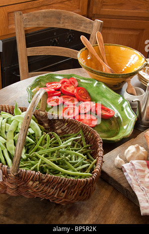 Vegetables in french country kitchen - Stock Photo