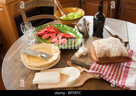 Table in french country kitchen - Stock Photo