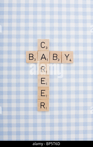 Game tile letters spelling career and baby - Stock Photo