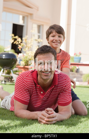 Father and son in the garden - Stock Photo