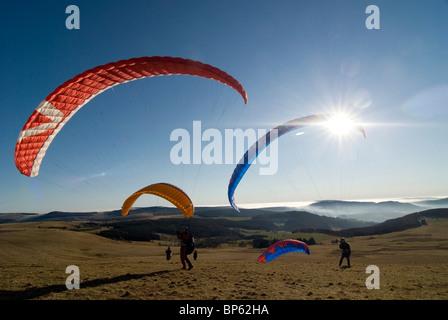 Paragliders on Wasserkuppe in the Rhoen UNESCO Biosphere Reserve, Hesse, Germany - Stock Photo