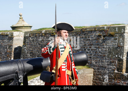Armed English Redcoats soldiers at British Army Fort George, a historical re-enacting event August, 2010 Inverness - Stock Photo