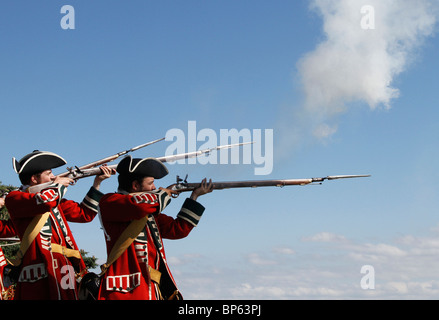 English Redcoats soldiers, firing muskets at the British Army Fort George, a historical re-enacting event August, - Stock Photo