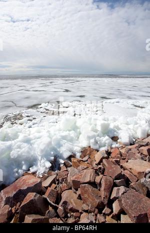 Melting sea ice blocks at seashore , Finland - Stock Photo