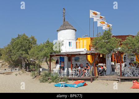 restaurant at the beach, Agios Georgios Bay near Naxos Town, Island of Naxos, Cyclades, Aegean Islands, Greece - Stock Photo