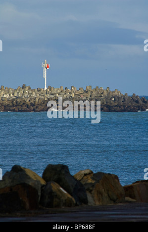 Red Harbor Entrance Marker on the South Jetty, at the channel into Humboldt Bay, California - Stock Photo