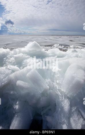 Melting ice blocks at seashore , Finland - Stock Photo