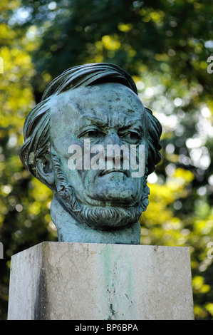Bronze Statue of head of Richard Wagner in the park in front of the Bayreuth Festival Richard Wagner Opera House - Stock Photo