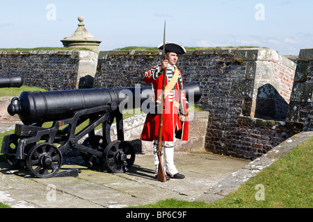Armed English Redcoats soldiers at British Army Fort George, bastions & redoubts an historical re-enacting event, - Stock Photo