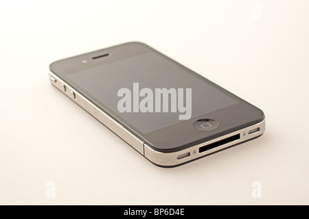 Brand new iPhone 4 over gray/white background - Stock Photo