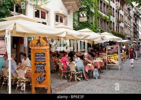 People sitting at an outdoors restaurant in Strasbourg Alsace France - Stock Photo