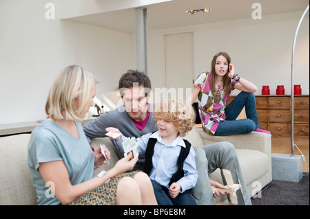 Family in a living room - Stock Photo
