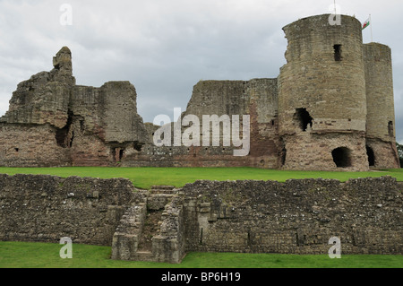 The ruins of Rhuddlan Castle seen against a brooding gray sky from across the dry moat, Rhyl, North Wales - Stock Photo