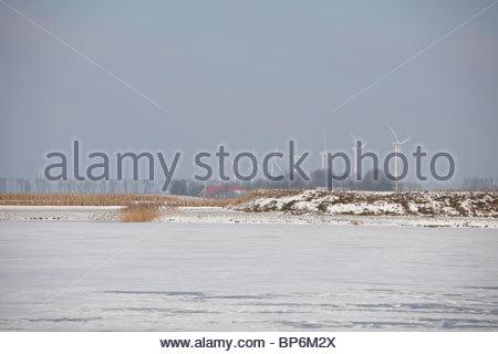 Winter scene with wind turbines in Flevoland, The Netherlands - Stock Photo