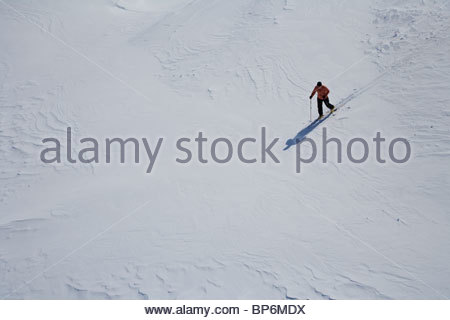 High angle view of mid adult man cross-country skiing in snow - Stock Photo